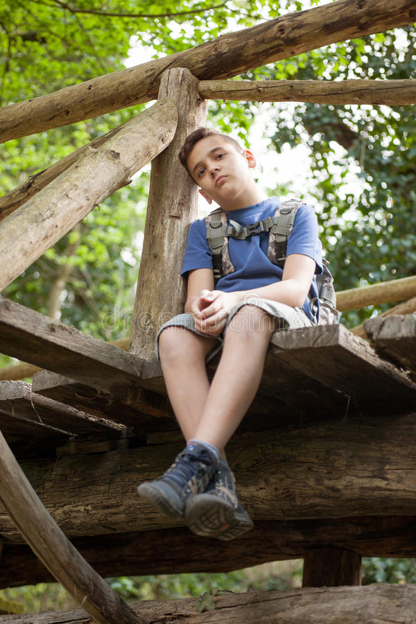 Lost unhappy child in the woods. Lost Boy Scouts in the woods stock image