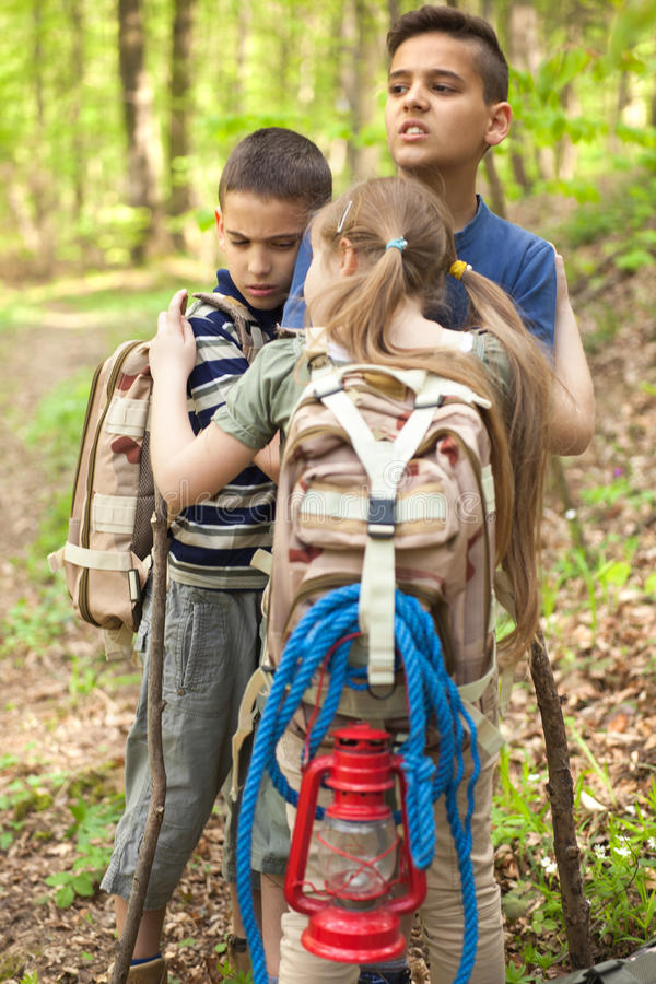 Lost unhappy children in the woods. Lost Boy Scouts in the woods royalty free stock photo