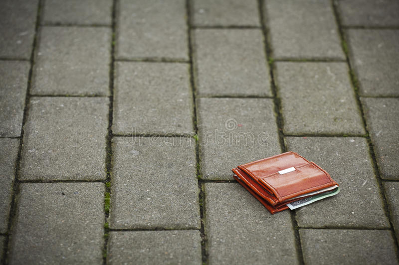 Lost wallet. Lost leather wallet with money lost at sidewalk stock photography
