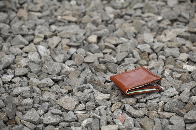 Lost wallet. Lost leather wallet with money lost at sidewalk stock photos