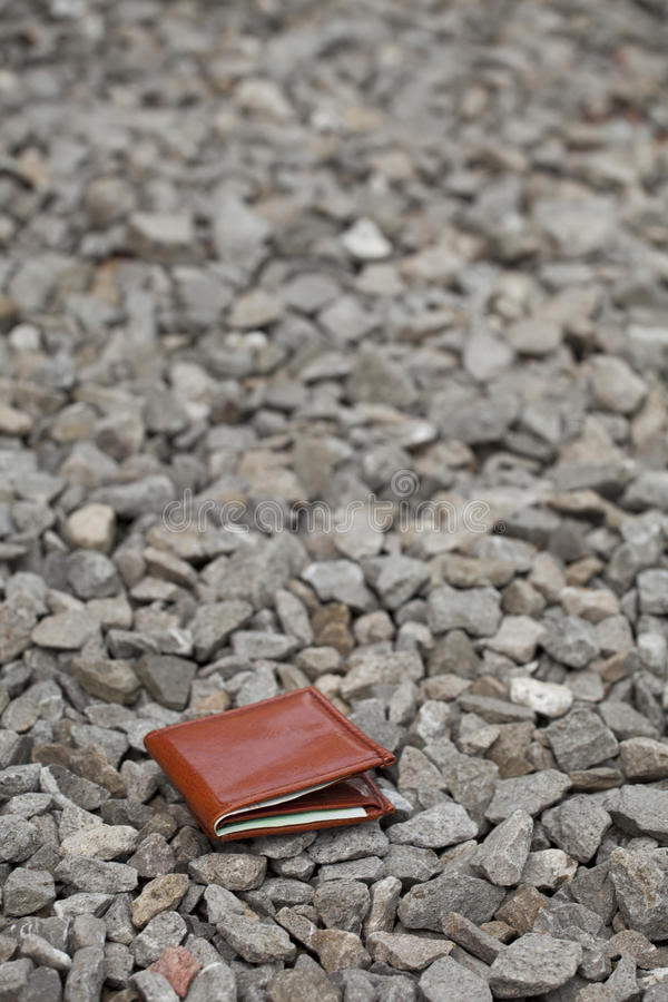 Lost wallet. Lost leather wallet with money lost at sidewalk royalty free stock image