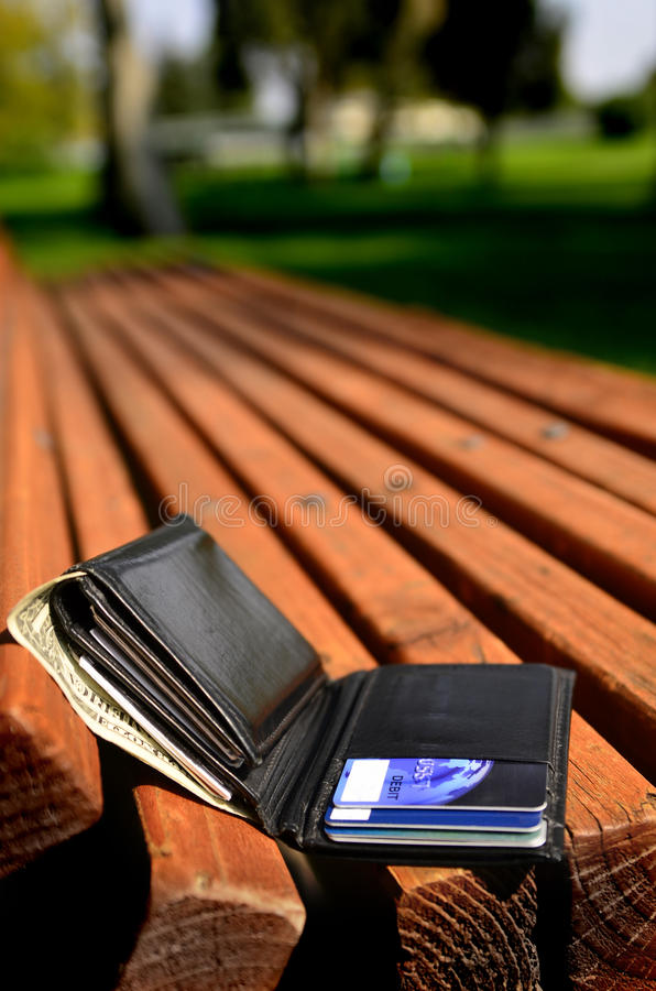 Lost Wallet. Left on bench with cash and credit cards stock images