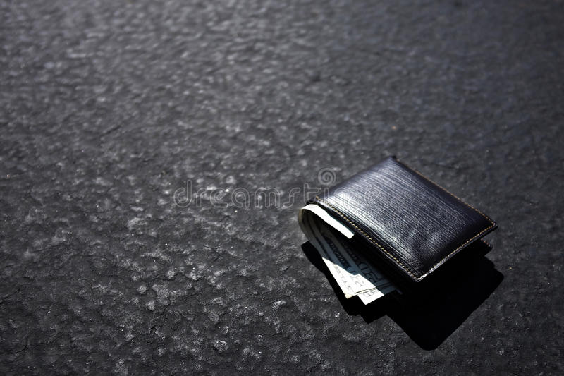 Lost Wallet Lying on Street or Road. Way road path with cash royalty free stock photo