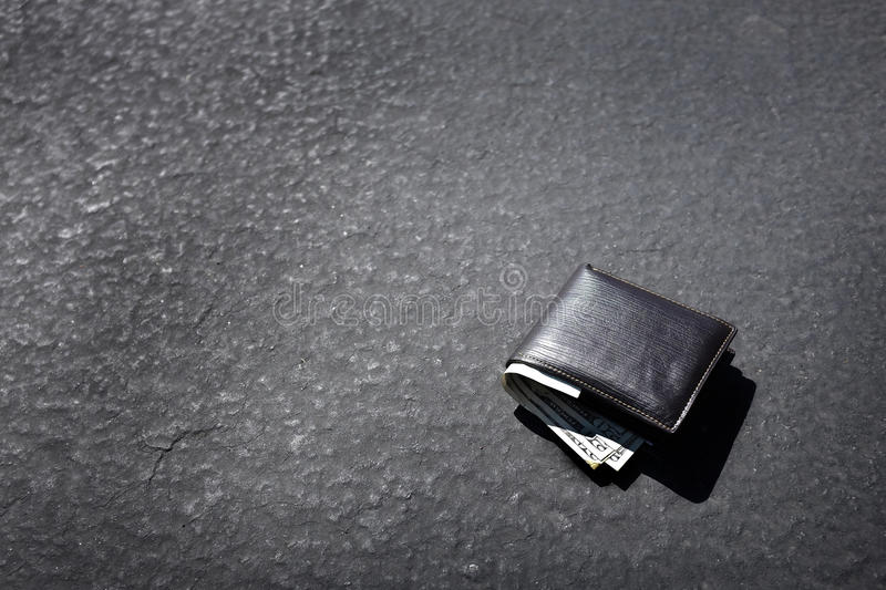 Lost Wallet Lying on Street or Road. Way road path with cash stock photography