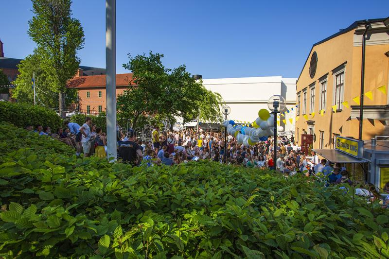 A lot av people celebrating Swedish National day on warm summer day. stock photo