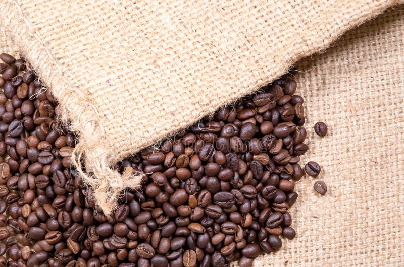 A lot of beans coffee with neck cloth background stock photos