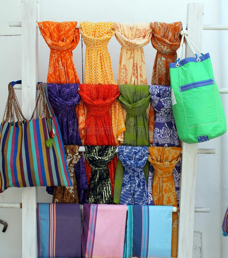 Colorful scarves and handkerchiefs hanging. A lot of beautiful and colorful scarves and handkerchiefs hanging on a hanger stock photo
