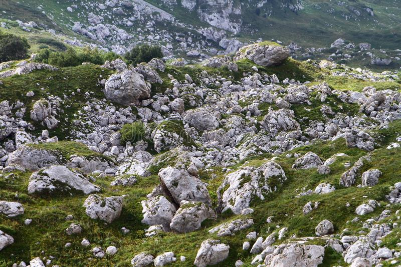 A lot of big stones on a mountain slope, natural texture photo royalty free stock photo
