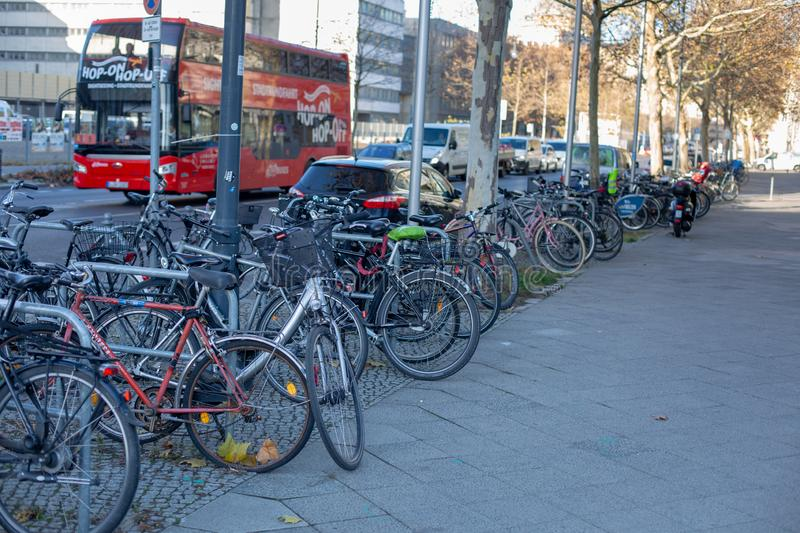 A lot of bikes parked on the sidewalk near the road. Berlin, Germany, December 2018 royalty free stock photography