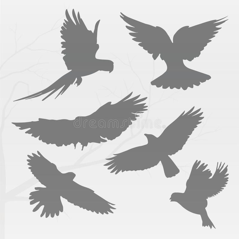 A lot of black birds. Flying in the cloudy autumn day and stock illustration