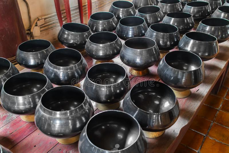 A lot of black monk`s bowl or almsbowl in the Buddhism temple Chiangmai, Thailand stock image