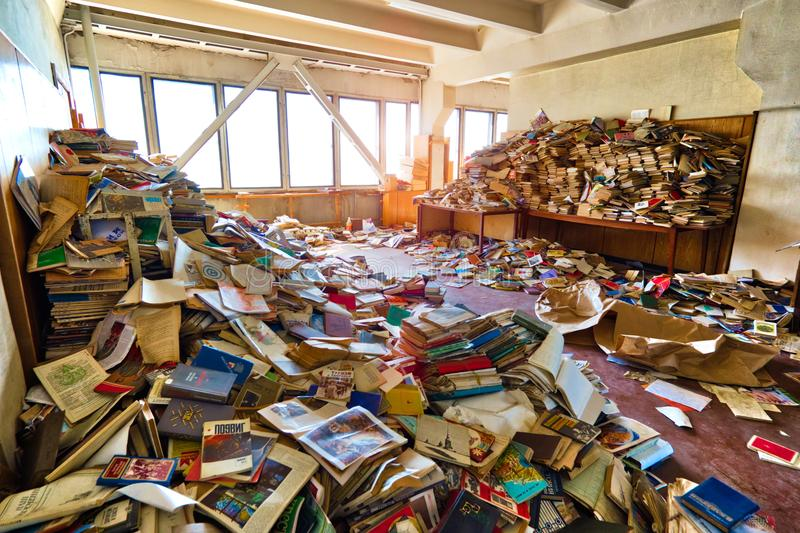A lot of books are scattered in the room stock images