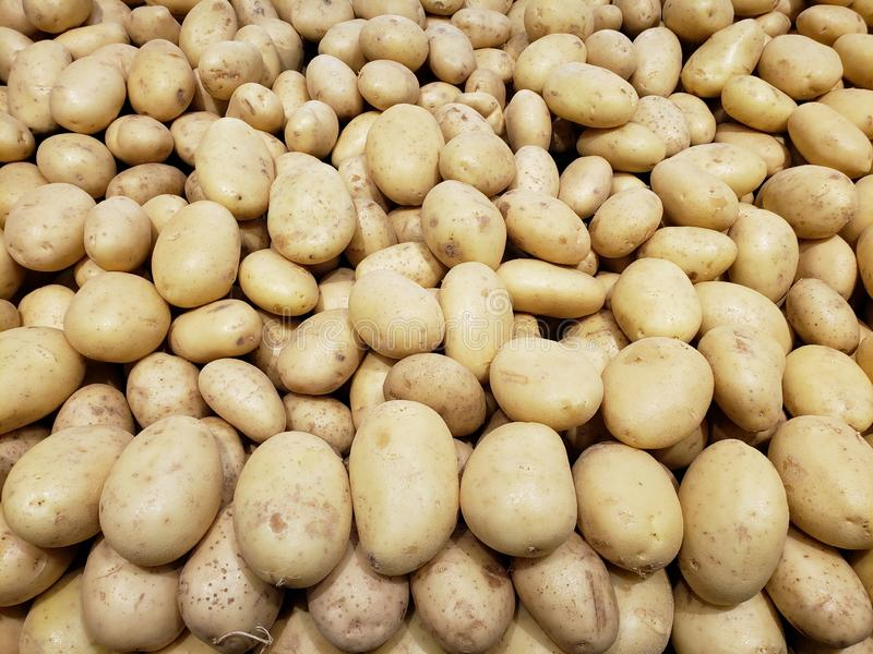 Lot of brown potato in a market, background and texture stock photos