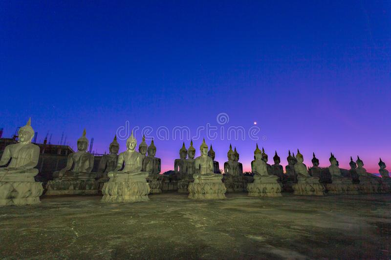A lot of Buddha statues in twilight. A lot of Buddha statues in the large field at Tungsong Nakornsrithammarat stock image