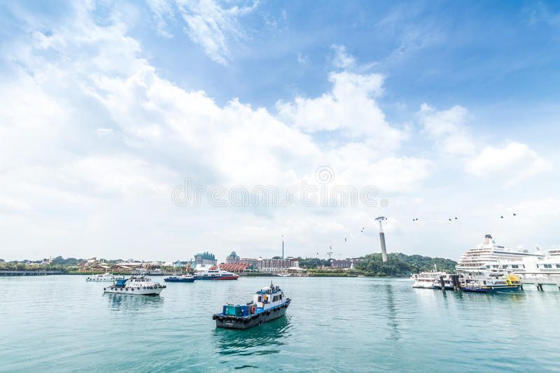 A lot of cargo ships in Singapore harbor. Cloudy day. royalty free stock images