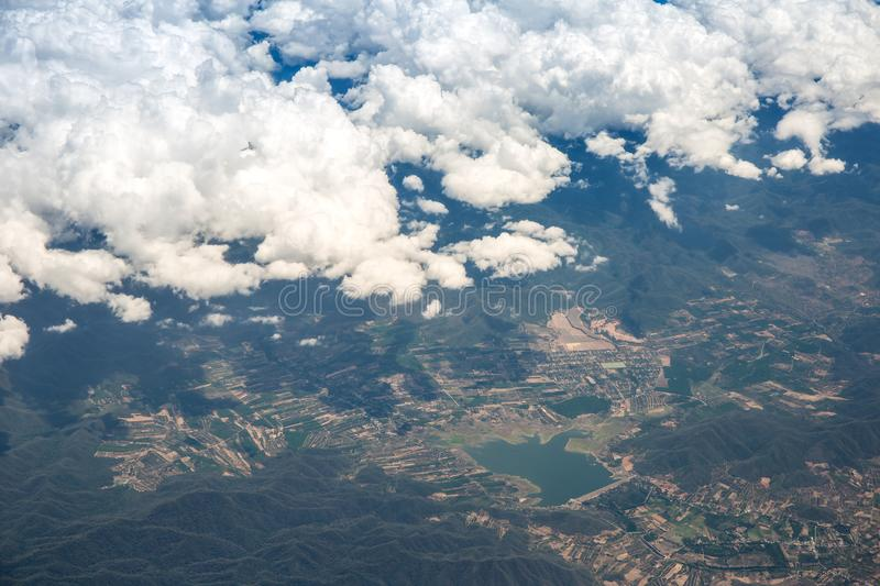 A lot of cloud in the sky from airplane window stock photo