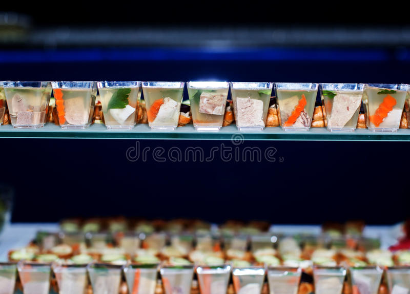 Lot of cold snacks on buffet table royalty free stock photography