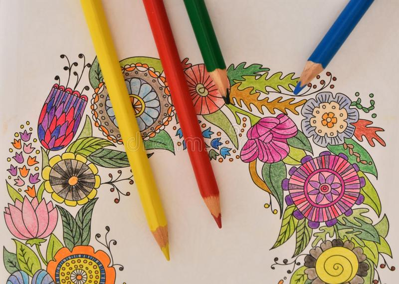 A lot of colored pencils on the coloring book - colorful rainbow royalty free stock photos