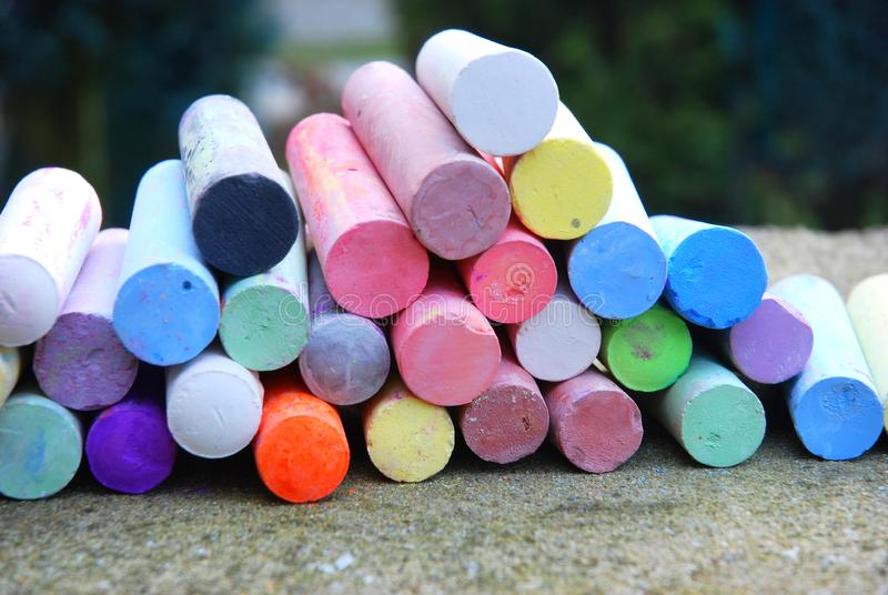 Colorful chalk crayons for street painting. A lot of colorful chalk crayons for painting on the asphalt royalty free stock images