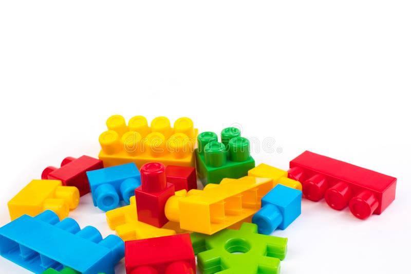 Lot of colorful rainbow toy bricks background. Educational toy, constructor for children Isolated on white background. Lot of colorful rainbow toy bricks stock photos