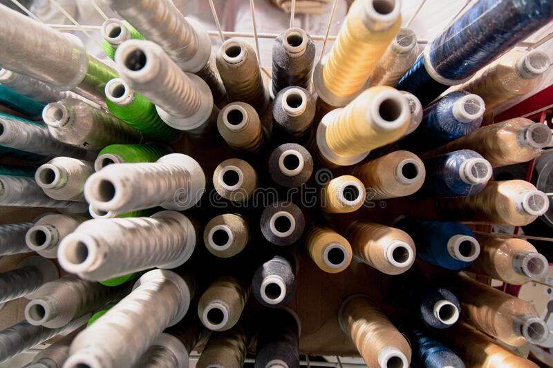 Lot of colorful sewing threads in a textile factory. A lot of colorful sewing threads in a textile factory stock photos