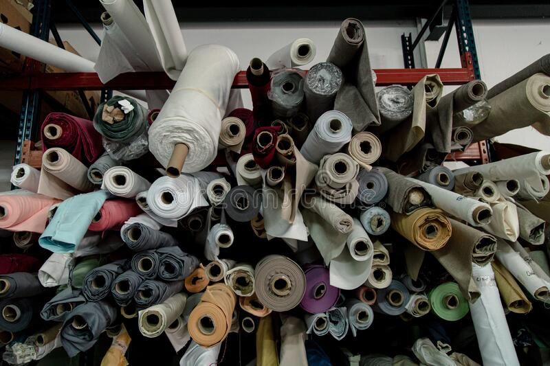 Lot of colorful textile rolls in a textile factory. A lot of colorful textile rolls in a textile factory stock photos