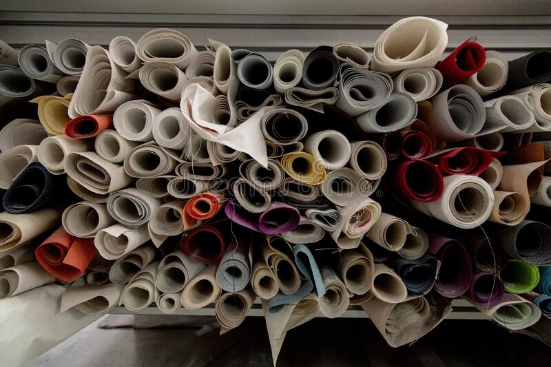 Lot of colorful textile rolls in a textile factory. A lot of colorful textile rolls in a textile factory royalty free stock photos