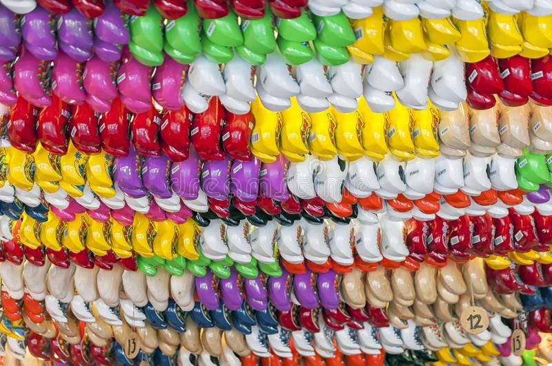 A lot of coloured dutch clogs. A lot of coloured Dutch wooden clogs hanging outdoor on a market place royalty free stock photography