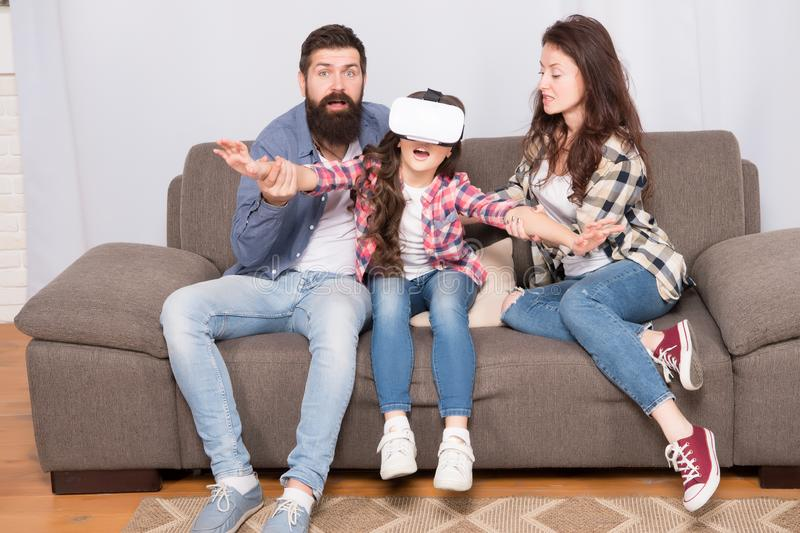 Lot of concern surrounding children using VR headsets. Daughter stuck in virtual reality. Digital world. Virtual life. And dependence. Parents worry about kid stock photo