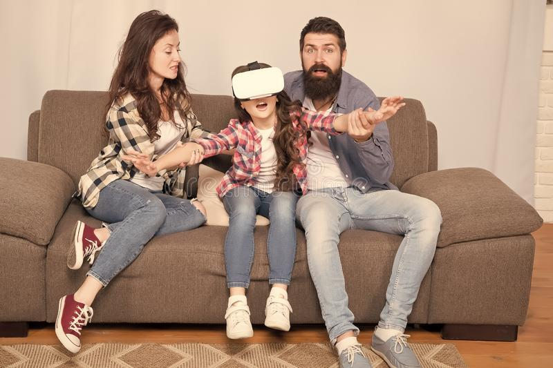 Lot of concern surrounding children using VR headsets. Daughter stuck in virtual reality. Digital world. Virtual life. And dependence. Parents worry about kid stock images