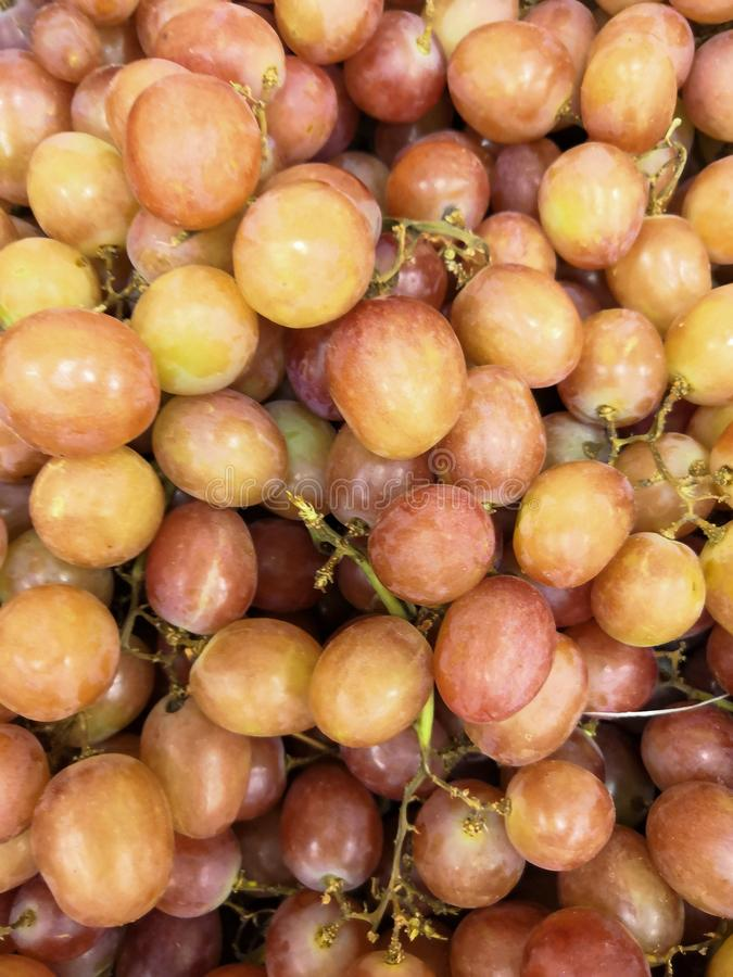 A lot of delicious grapes at the market. Fruit background. Organic and healthy royalty free stock image