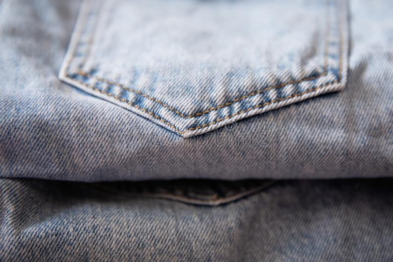 Lot of denim blue jean texture is the classic indigo fashion. stock photos