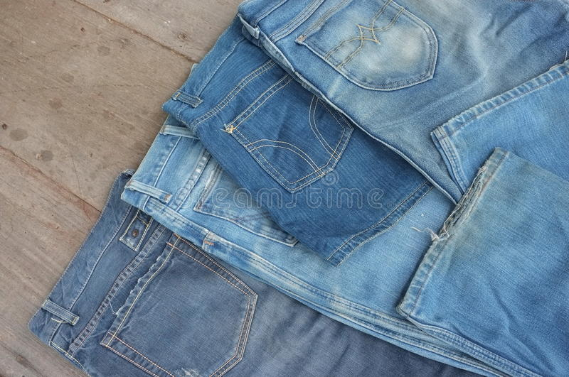 Lot of different blue jeans royalty free stock photography