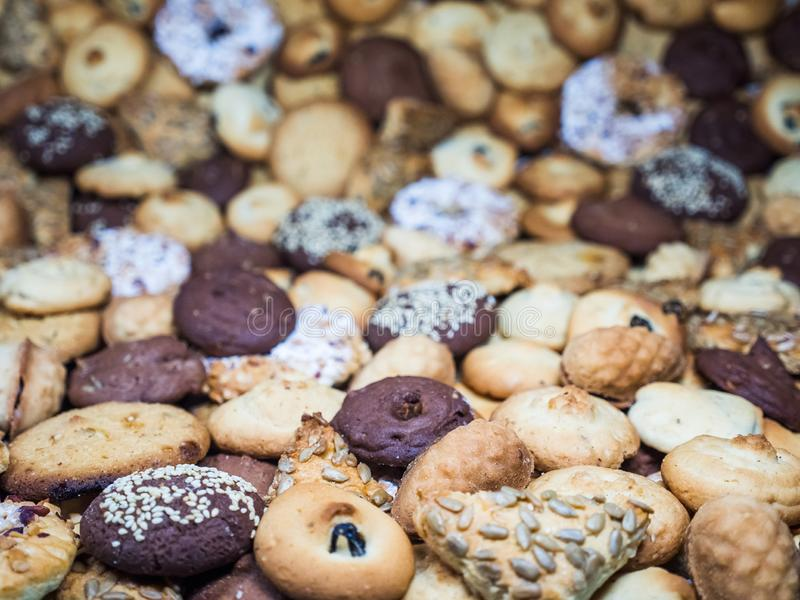 A lot of different cookies filling the whole picture, with different depth of field frame. stock images