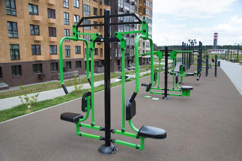 A lot of different fitness equipment made of metal on the Playground in the city outdoors. Sport is a healthy lifestyle stock photo