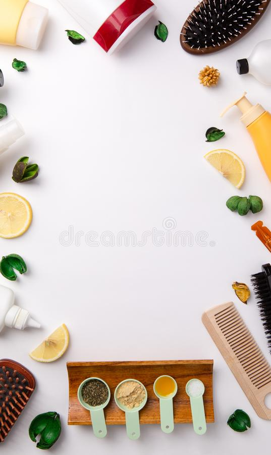 A lot of different natural cosmetic products for hair care on white table. royalty free stock image