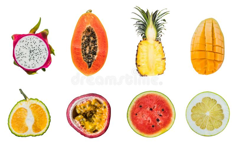A lot of different tropical fruits cut halves isolated on white royalty free stock photography