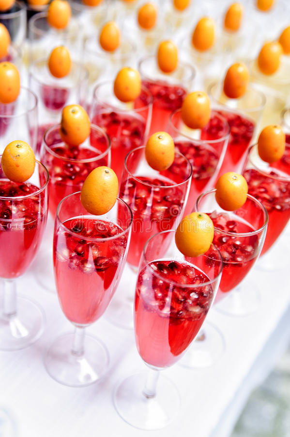 Lot of drinks on a buffet table. Lot of red sparkling drinks on buffet table stock image