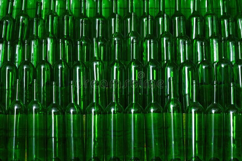 A lot of empty green red wine bottles royalty free stock photography