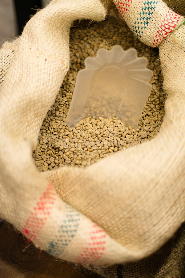 Lot of Ethiopian coffee. With scoop royalty free stock photos