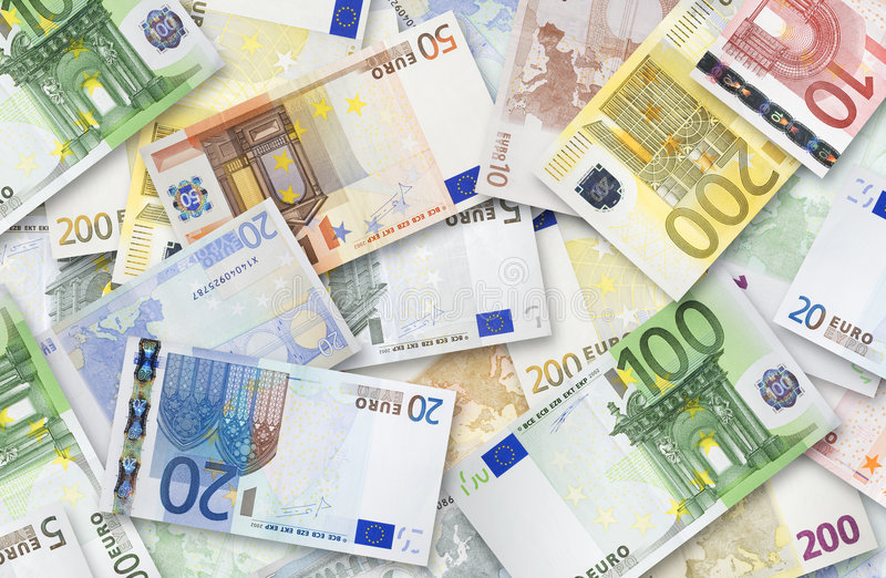 Lot of Euro banknotes. Euro banknotes of 200, 100, 50, 20, 10 and 5 Euroes spread randomly on a table royalty free stock image