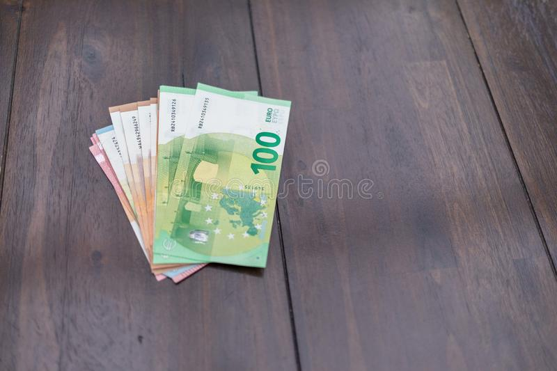 lot of euro banknotes lying spread out on a dark table stock images