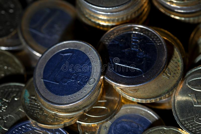 A lot of euro coins and cents on black. Background royalty free stock photos