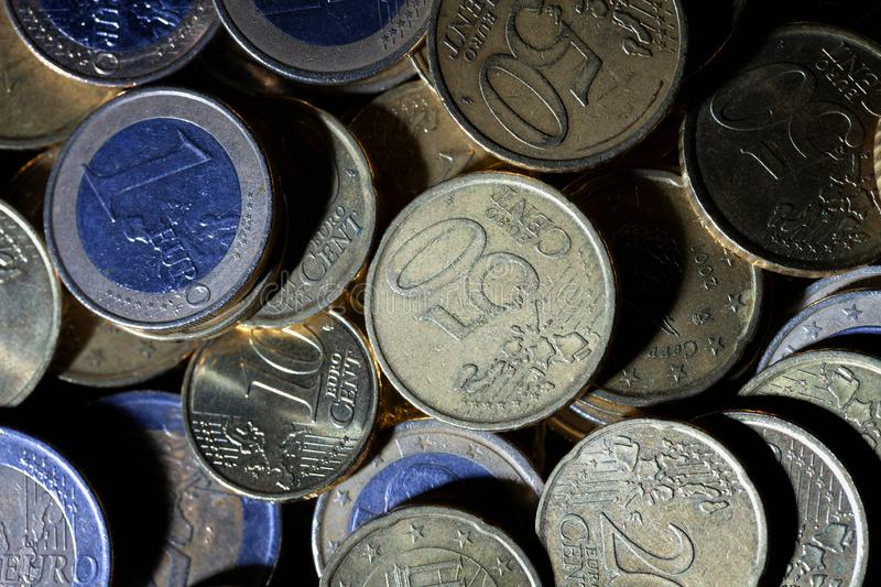 A lot of euro coins and cents on black. Background stock photos