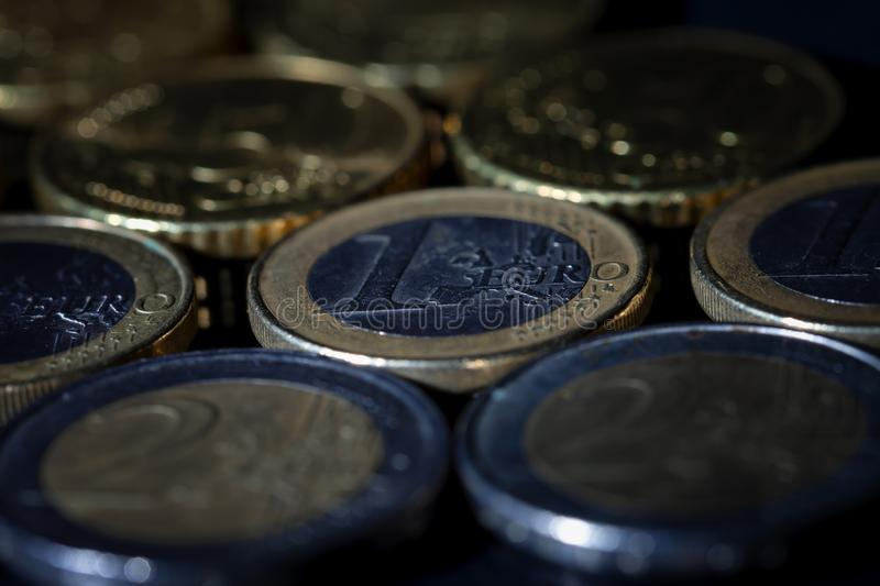 A lot of euro coins and cents on black. Background stock image