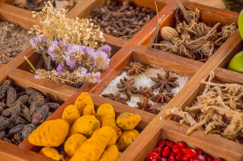 Lot of flavourings, species and condiments in the wooden box royalty free stock image