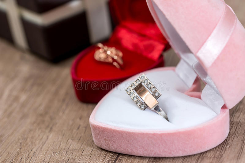 Lot of gift boxes with gold jewelry royalty free stock photography