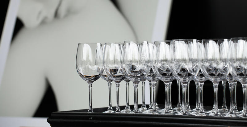 A lot of glasses for drinks stock images