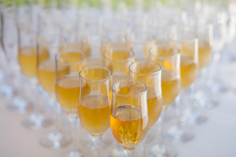Lot of glasses filled with champagne. On the party table royalty free stock images