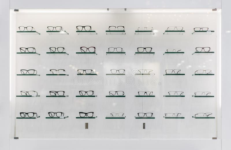 A lot of glasses. At isolated shopping window stock images